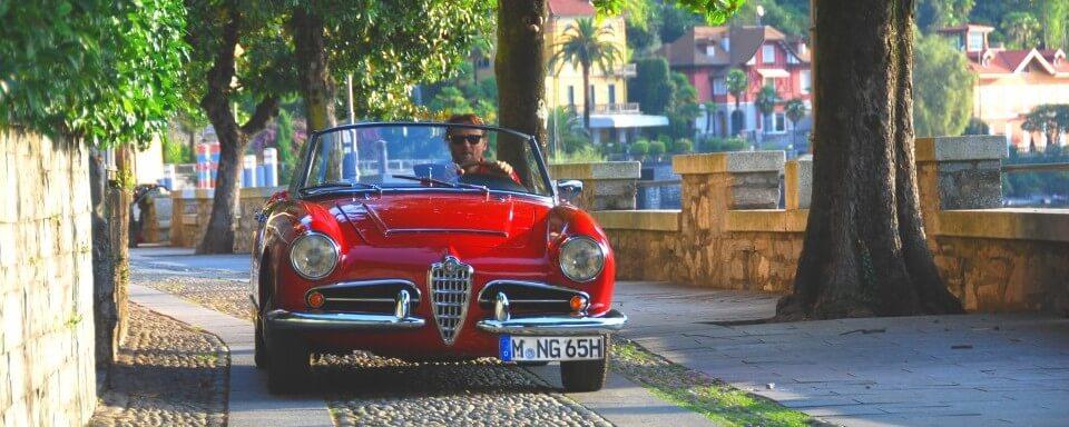 Lago Maggiore Cannero Riviera Alfa Romeo Giulia Spider Veloce rot | Nostalgic Oldtimerreisen